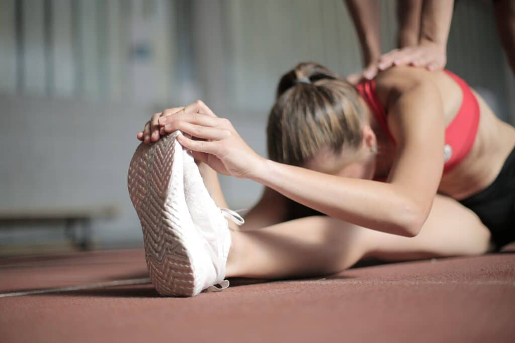 photo of woman stretching 3796796 scaled